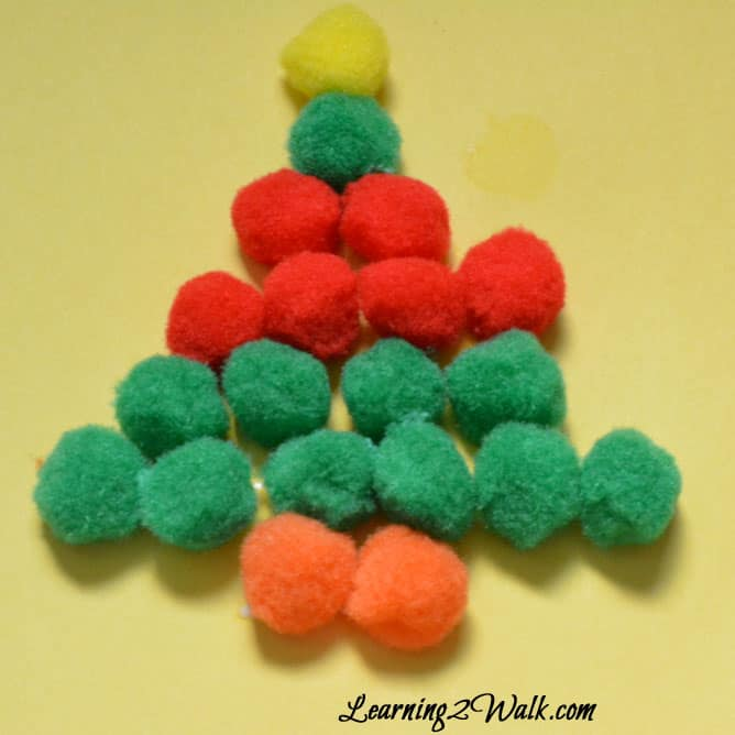 Christmas here we come! I love these simple christmas tree crafts for kids- a christmas tree with pom poms and stickers