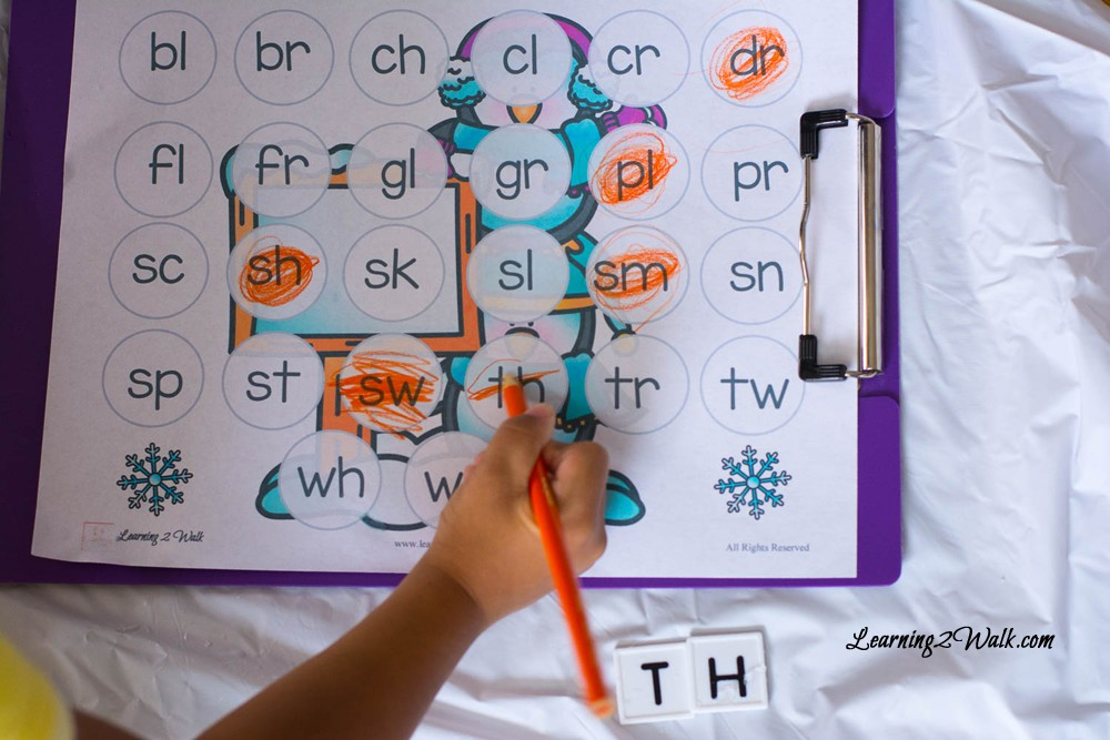 Our arctic preschool letter hunt activity was a fun and messy one. We dug in the snow to find our missing letters and match them to our preschool letter worksheet. We even did a few blends activities as well.