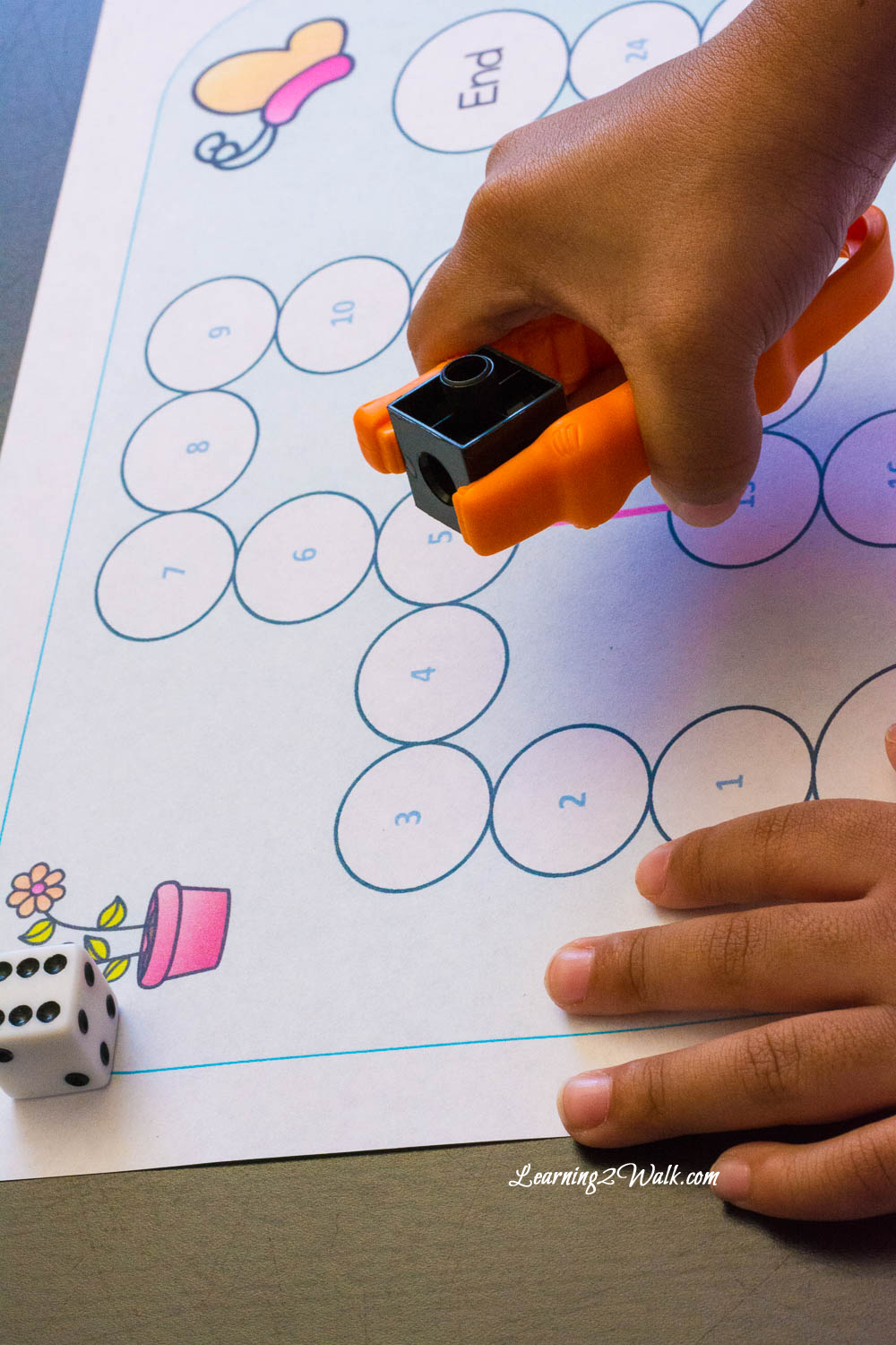 Who says learning to read had to be boring? My kids enjoyed using this fun gameboard and tongs to create a fun long vowel activity