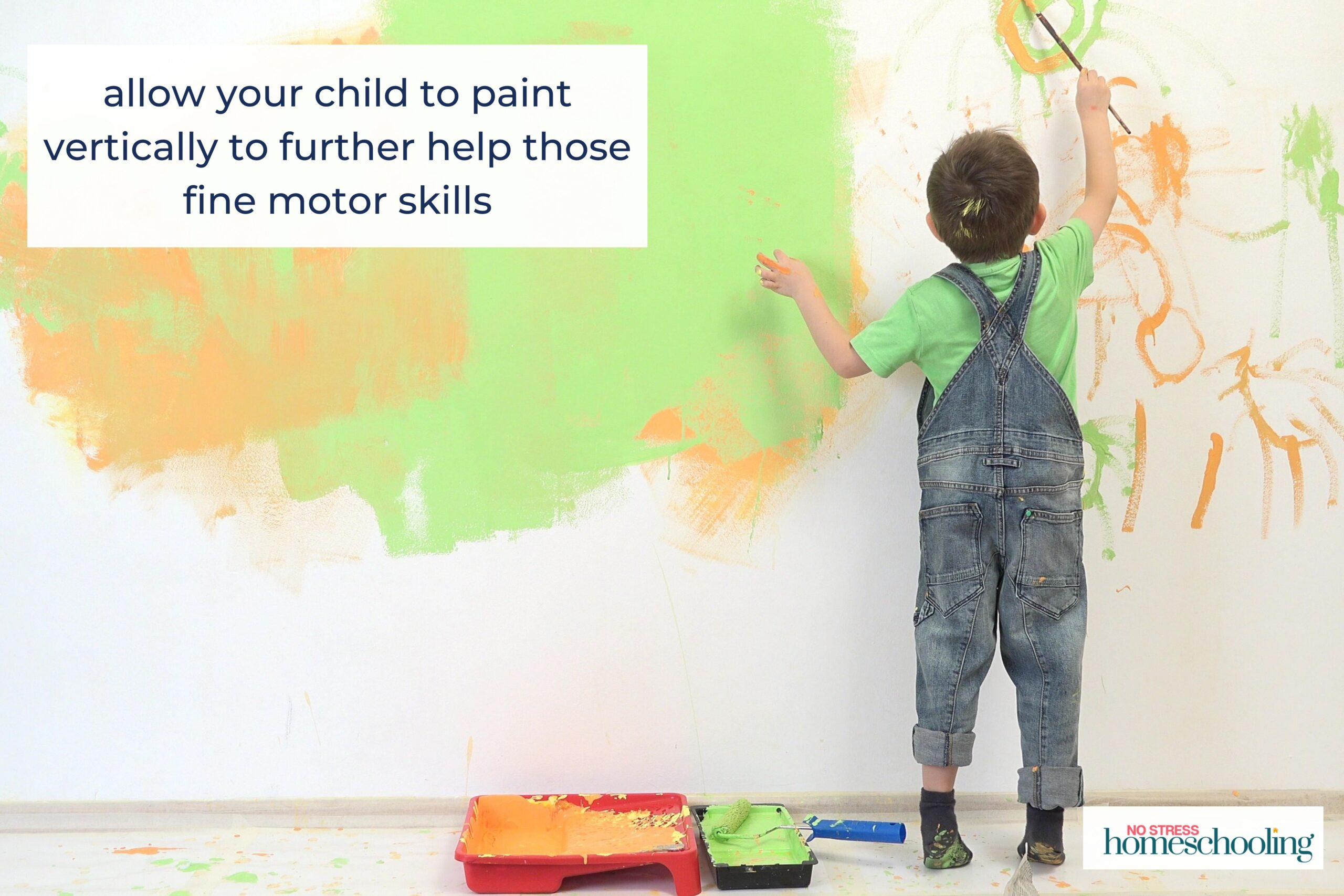 paint vertically to help with fine motor skills and pencil grasp development image